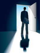 1372902-a-businessman-is-standing-in-front-of-an-open-door