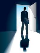 1372902-a-businessman-is-standing-in-front-of-an-open-door