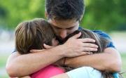 father-hugging-children